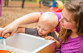 Toddler at Water Table
